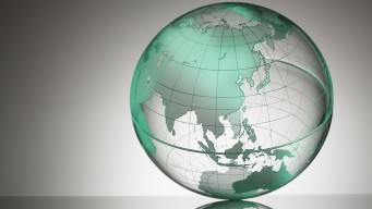 a transparent globe showing Asia