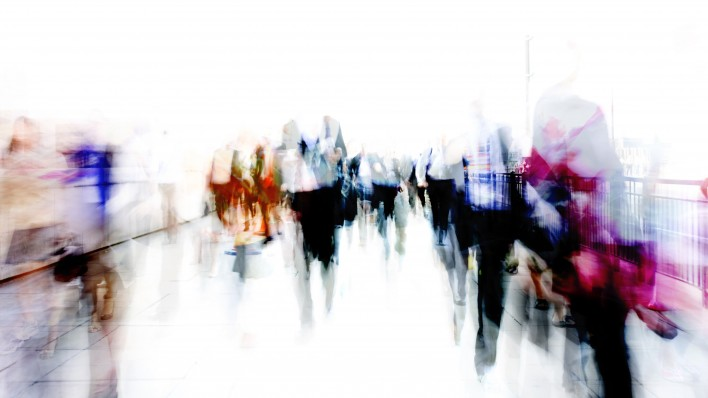 blurred abstrat image of people on city street