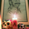 "A detail of the altar set up in observance of the Mexican ""Dia De Lost Muertos."" It will remain until World AIDS Day."