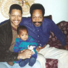 Left: Demetrius Parker in 1996 holding his young son Vitthal and seated next to his late father, John H. Parker Senior. Right: Demetrius today.