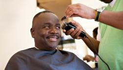 African American Barber Shop Smile man getting hair cut