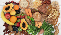 food with high fiber content for a healthy diet with fruit, vegetables, whole wheat bread, pasta, nuts, legumes, grains and cereals