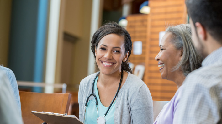 Healthcare professional talks with patients