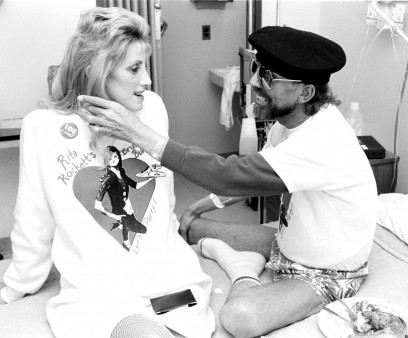 Ward 5B caregiver Rita Rockett visits with a patient.